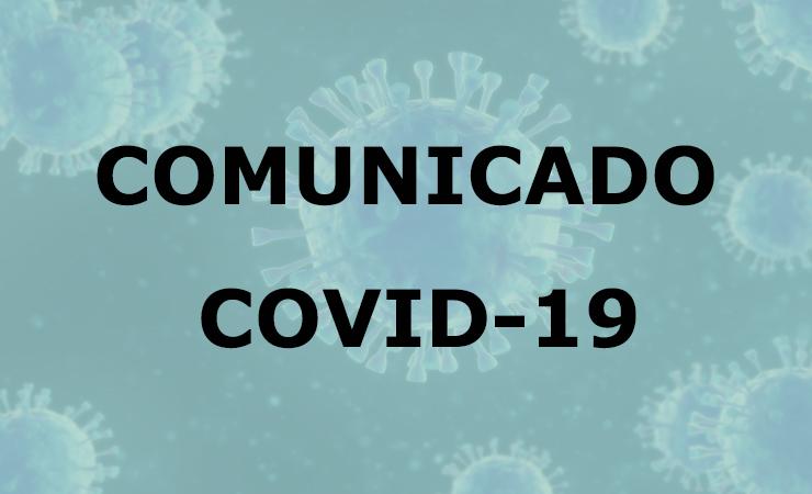 O texto Comunicado Covid-19 e de fundo uma imagem de vírus.